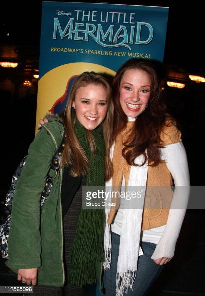Actress Emily Osment poses with Actress Sierra Boggess as she visits backstage at 'Disney's The Little Mermaid' on Broadway at The Lunt Fontanne...