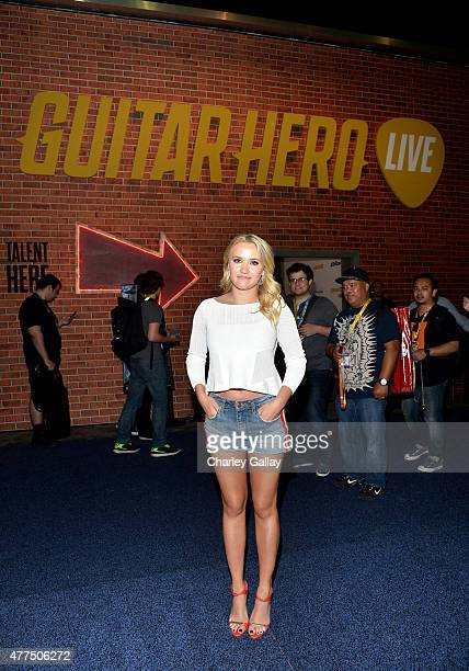 Actress Emily Osment stops by Activision's Guitar Hero Live booth at E3 to check out GHTV the world's first playable music video network at the Los...
