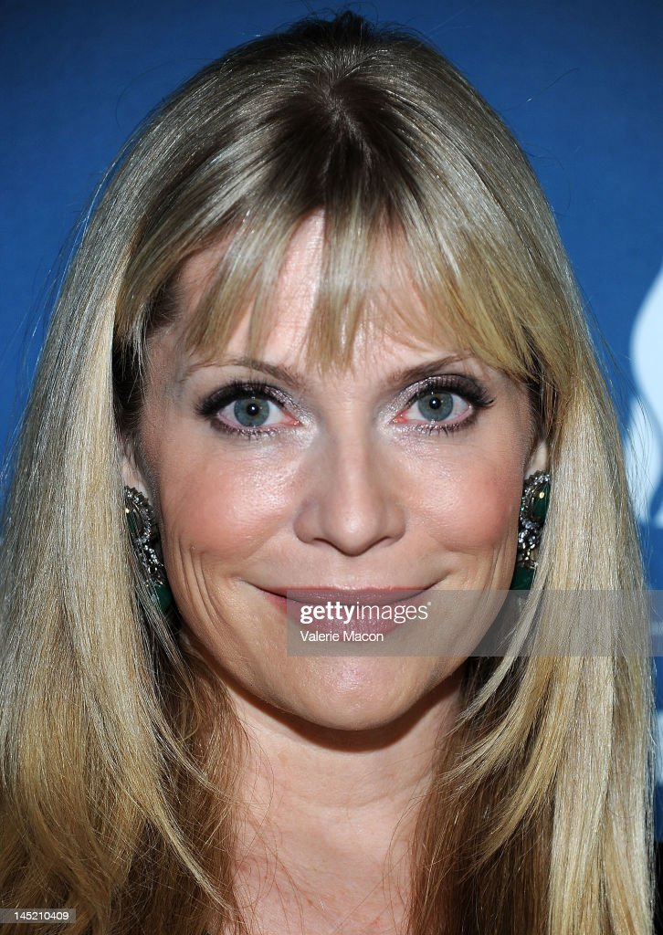 Actress Emily Proctor arrives at the Simon Wiesenthal Center's Annual National Tribute Dinner Honoring Jerry Bruckheimer at The Beverly Hilton Hotel on May 23, 2012 in Beverly Hills, California.