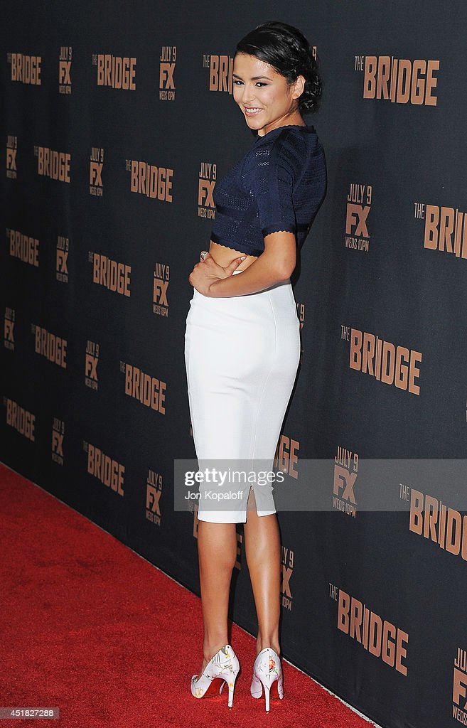 Actress <a gi-track='captionPersonalityLinkClicked' href=/galleries/search?phrase=Emily+Rios&family=editorial&specificpeople=812294 ng-click='$event.stopPropagation()'>Emily Rios</a> arrives at the FX's 'The Bridge' Season 2 Premiere at Pacific Design Center on July 7, 2014 in West Hollywood, California.