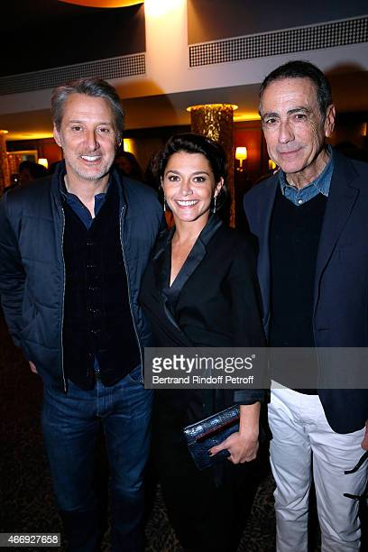 Actress Emma de Caunes standing between her father Antoine de Caunes and her father in the movie Alain Chamfort attend the Cocktail for the Cinema...