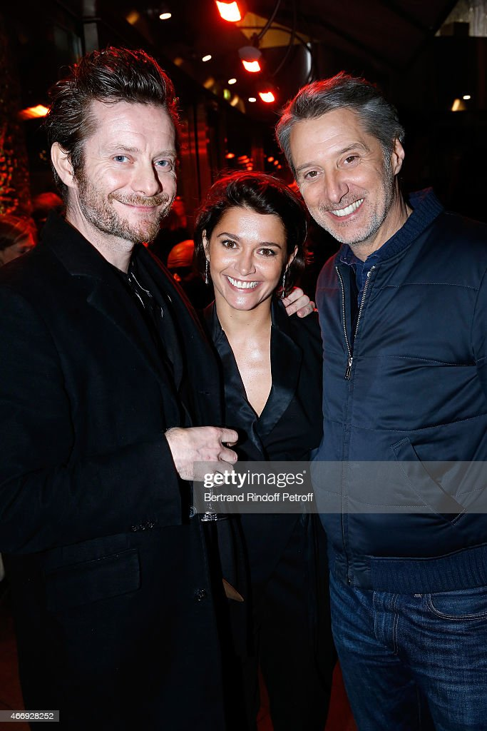Actress <a gi-track='captionPersonalityLinkClicked' href=/galleries/search?phrase=Emma+de+Caunes&family=editorial&specificpeople=606874 ng-click='$event.stopPropagation()'>Emma de Caunes</a> standing between her father Antoine de Caunes (R) and her husband cartoonist <a gi-track='captionPersonalityLinkClicked' href=/galleries/search?phrase=Jamie+Hewlett&family=editorial&specificpeople=828886 ng-click='$event.stopPropagation()'>Jamie Hewlett</a> (L) attend the Cocktail for the Cinema Award 2015 of Foundation Diane & Lucien Barriere, given to the movie 'Les Chateaux de Sable'. Held at Le Fouquet's on March 19, 2015 in Paris, France.