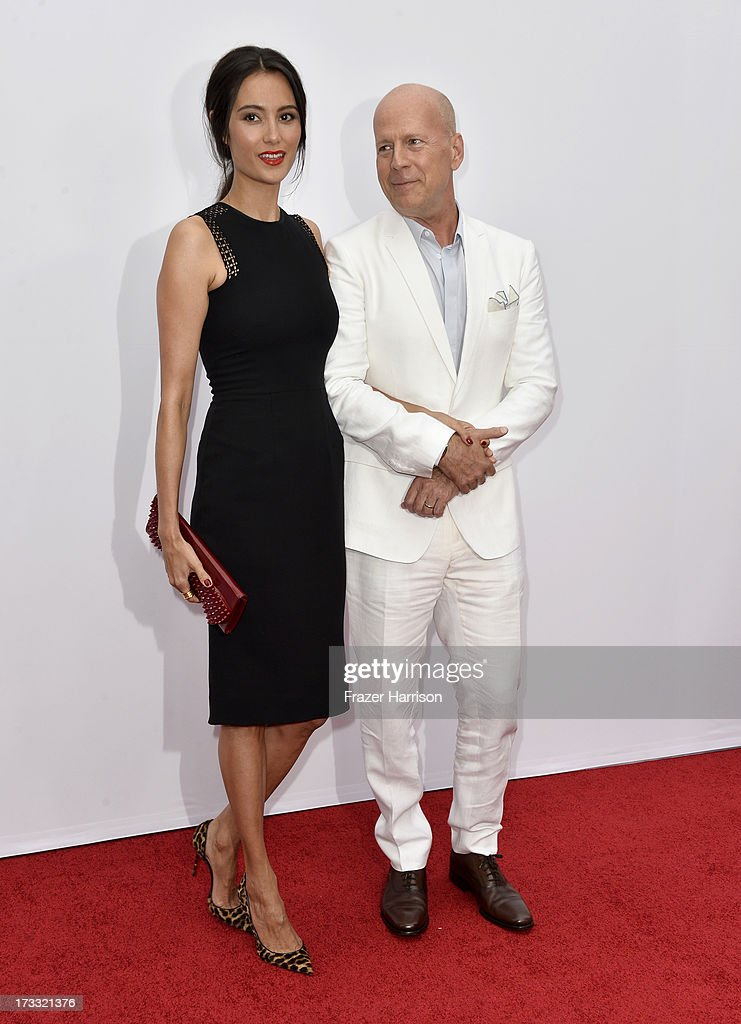 Actress Emma Heming and actor Bruce Willis attend the premiere of Summit Entertainment's 'RED 2' at Westwood Village on July 11, 2013 in Los Angeles, California.