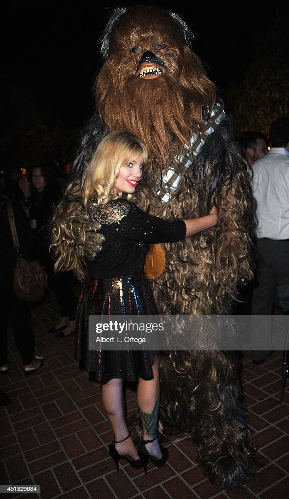 Actress Emma Julia Jacobs poses with Chewbacca at the After Party for the 40th Annual Saturn Awards held at on June 26, 2014 in Burbank, California.