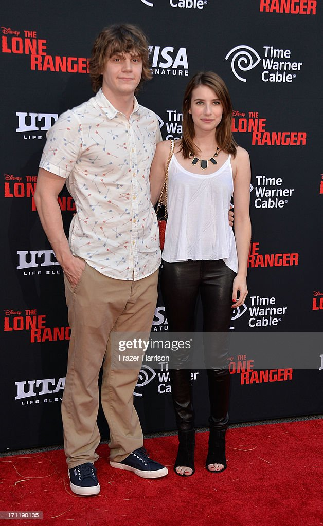 Actress <a gi-track='captionPersonalityLinkClicked' href=/galleries/search?phrase=Emma+Roberts&family=editorial&specificpeople=226535 ng-click='$event.stopPropagation()'>Emma Roberts</a> (L) and Evan Peters arrive at the premiere of Walt Disney Pictures' 'The Lone Ranger' at Disney California Adventure Park on June 22, 2013 in Anaheim, California.