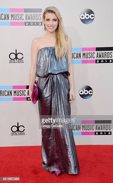 Actress Emma Roberts arrives at the 2013 American Music Awards at Nokia Theatre LA Live on November 24 2013 in Los Angeles California