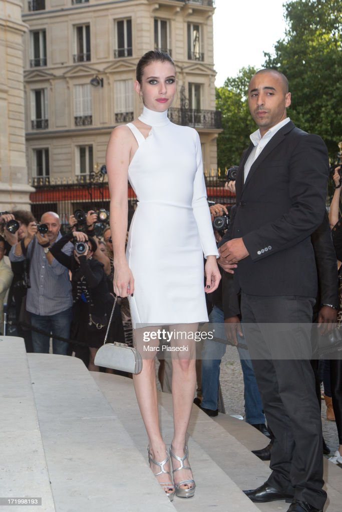 Actress <a gi-track='captionPersonalityLinkClicked' href=/galleries/search?phrase=Emma+Roberts&family=editorial&specificpeople=226535 ng-click='$event.stopPropagation()'>Emma Roberts</a> arrives to attend the Versace show as part of Paris Fashion Week Haute-Couture Fall/Winter 2013-2014 on June 30, 2013 in Paris, France.