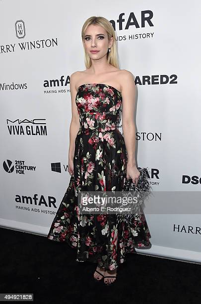 Actress Emma Roberts attends amfAR's Inspiration Gala Los Angeles at Milk Studios on October 29 2015 in Hollywood California