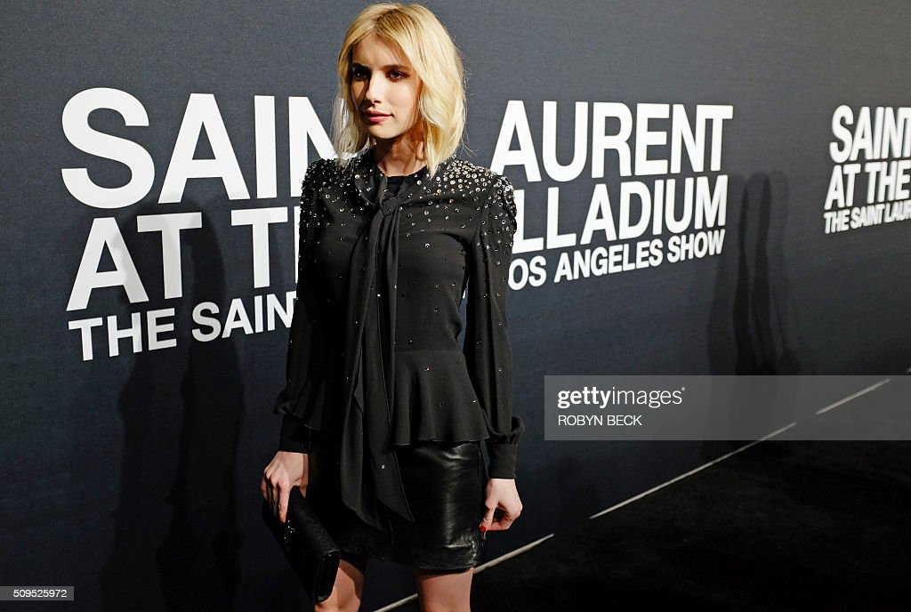Actress Emma Roberts attends the Saint Laurent men's fall line and the first part of its women's collection fashion show at the Paladium, in Hollywood, California, February 10, 2016. / AFP / ROBYN BECK