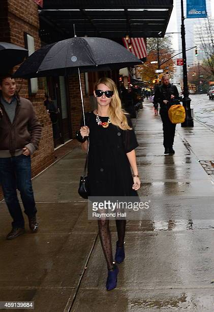 Actress Emma Roberts is seen in Soho in the rain on November 13 2014 in New York City