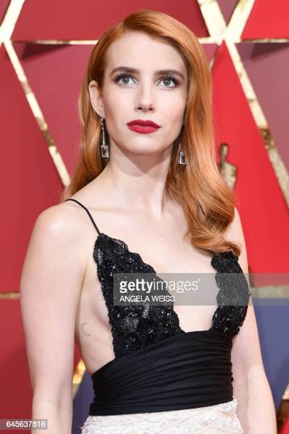 US actress Emma Roberts poses as she arrives on the red carpet for the 89th Oscars on February 26 2017 in Hollywood California / AFP / ANGELA WEISS