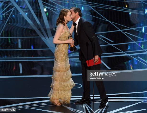 Actress Emma Stone and accepts Best Actress for 'La La Land' from actor Leonardo DiCaprio onstage during the 89th Annual Academy Awards at Hollywood...