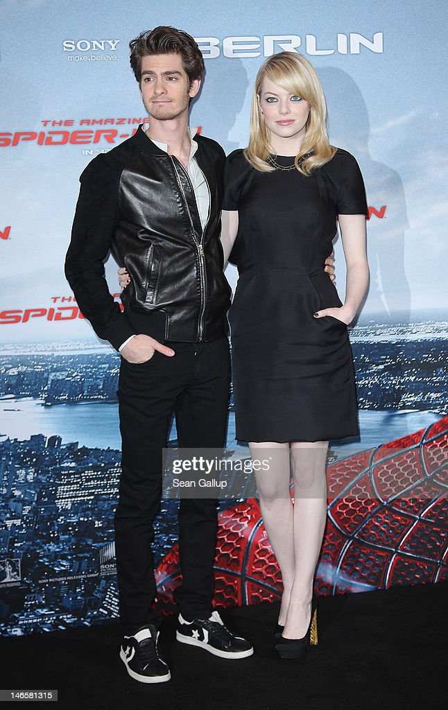 Actress <a gi-track='captionPersonalityLinkClicked' href=/galleries/search?phrase=Emma+Stone&family=editorial&specificpeople=672023 ng-click='$event.stopPropagation()'>Emma Stone</a> and actor <a gi-track='captionPersonalityLinkClicked' href=/galleries/search?phrase=Andrew+Garfield&family=editorial&specificpeople=4047840 ng-click='$event.stopPropagation()'>Andrew Garfield</a> attend a photocall for 'The Amazing Spider-Man' at the Adlon Hotel on June 20, 2012 in Berlin, Germany.