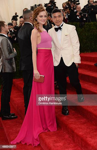 Actress Emma Stone and designer Thakoon Panichgul attend the 'Charles James Beyond Fashion' Costume Institute Gala at the Metropolitan Museum of Art...