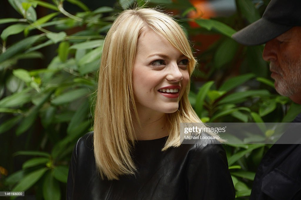 Actress <a gi-track='captionPersonalityLinkClicked' href=/galleries/search?phrase=Emma+Stone&family=editorial&specificpeople=672023 ng-click='$event.stopPropagation()'>Emma Stone</a> and Producer <a gi-track='captionPersonalityLinkClicked' href=/galleries/search?phrase=Avi+Arad&family=editorial&specificpeople=208963 ng-click='$event.stopPropagation()'>Avi Arad</a> attend the 'The Amazing Spider-Man' New York City Photo Call at Crosby Street Hotel on June 9, 2012 in New York City.