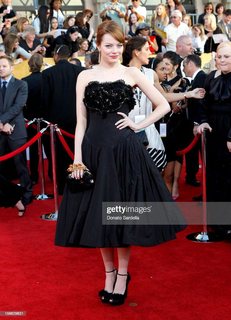 Actress <a gi-track='captionPersonalityLinkClicked' href=/galleries/search?phrase=Emma+Stone&family=editorial&specificpeople=672023 ng-click='$event.stopPropagation()'>Emma Stone</a> arrives at the 18th Annual Screen Actors Guild Awards held at The Shrine Auditorium on January 29, 2012 in Los Angeles, California.