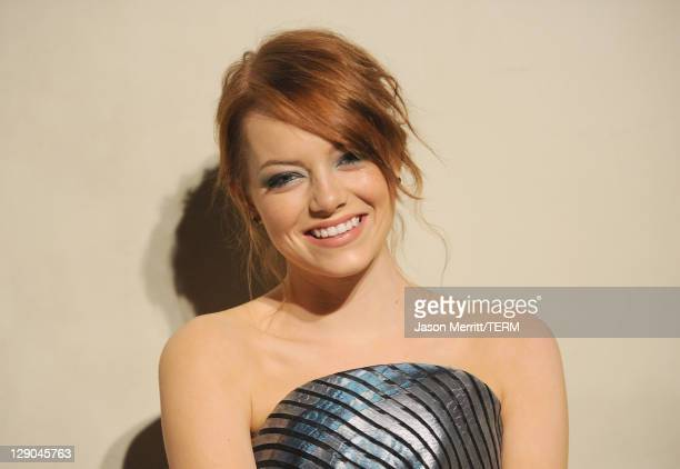 Actress Emma Stone arrives at the Giorgio Armani / Vanity Fair private dinner on October 11 2011 in Los Angeles California