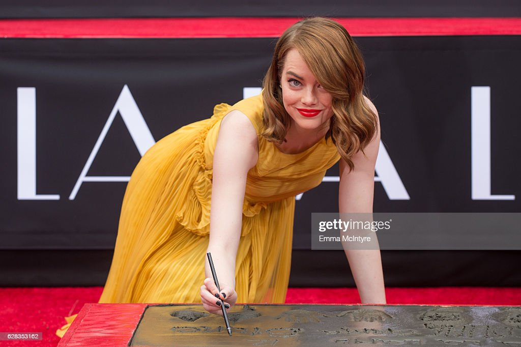 Actress Emma Stone attends 'Ryan Gosling and Emma Stone hand and footprint ceremony' at TCL Chinese Theatre IMAX on December 7, 2016 in Hollywood, California.