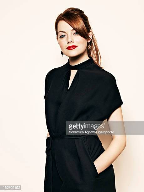 Actress Emma Stone is photographed for Madame Figaro on September 1 2011 in Paris France Published image Figaro ID 101741002 Dress by Valentino...