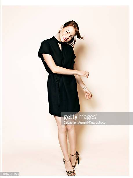 Actress Emma Stone is photographed for Madame Figaro on September 1 2011 in Paris France Published image Figaro ID 101741003 Dress by Valentino...