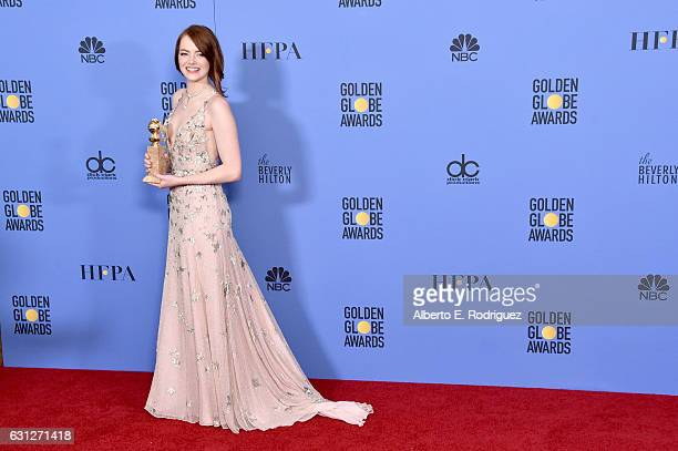 Actress Emma Stone poses in the press room during the 74th Annual Golden Globe Awards at The Beverly Hilton Hotel on January 8 2017 in Beverly Hills...