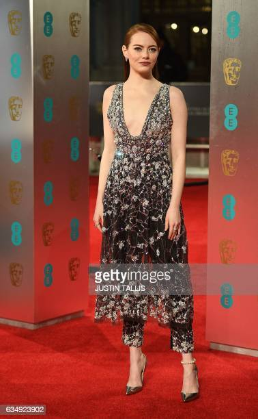 US actress Emma Stone poses upon arrival at the BAFTA British Academy Film Awards at the Royal Albert Hall in London on February 12 2017 / AFP PHOTO...