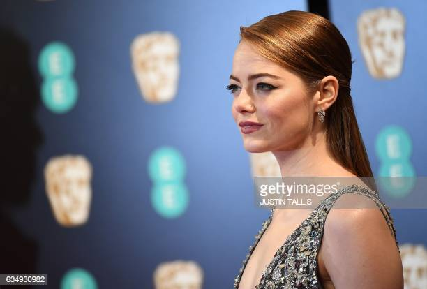US actress Emma Stone poses upon arrival at the BAFTA British Academy Film Awards at the Royal Albert Hall in London on February 12 2017 / AFP /...