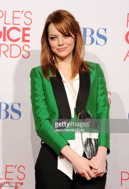 Actress Emma Stone poses with Favorite Movie Actress Award for 'The Help' 'Crazy Stupid Love' in the press room during the 2012 People's Choice...