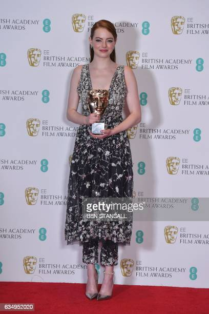 US actress Emma Stone poses with the award for a Leading Actress for her work on the film 'La La Land' at the BAFTA British Academy Film Awards at...