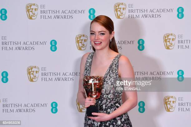 TOPSHOT US actress Emma Stone poses with the award for a Leading Actress for her work on the film 'La La Land' at the BAFTA British Academy Film...