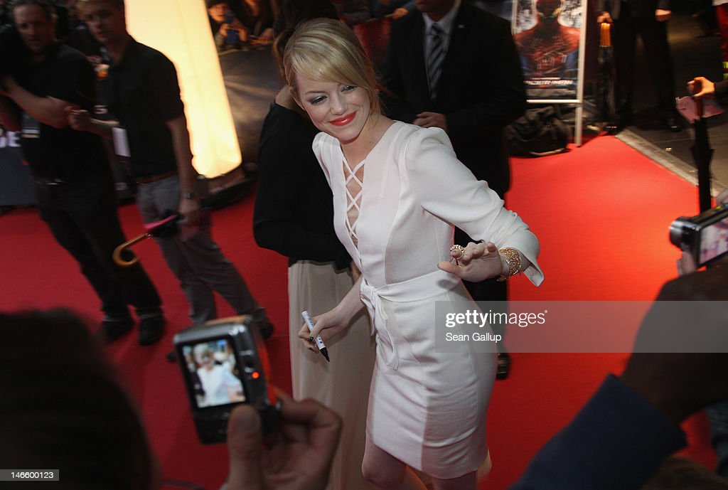 Actress <a gi-track='captionPersonalityLinkClicked' href=/galleries/search?phrase=Emma+Stone&family=editorial&specificpeople=672023 ng-click='$event.stopPropagation()'>Emma Stone</a> signs autographs for fans at the Germany premiere of 'The Amazing Spider-Man' at Sony Center on June 20, 2012 in Berlin, Germany.