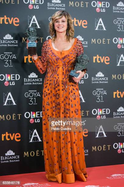 Actress Emma Suarez holds the award for the best actress in a leading role award for the film 'Julieta' during the 31st edition of the Goya Cinema...