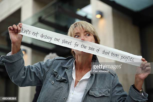 Actress Emma Thomson joins Greenpeace climate change activists outside the Shell building on September 29 2015 in London England The event was marked...