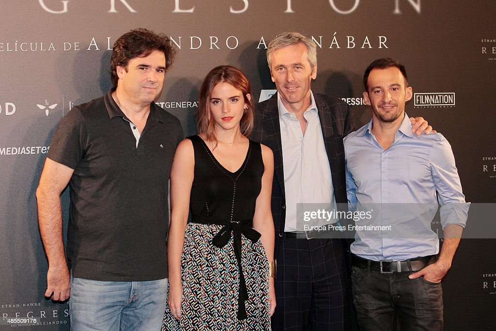 Actress Emma Watson and director Alejandro Amenabar (R) attend 'Regression' photocall at Villamagna hotel on August 27, 2015 in Madrid, Spain.