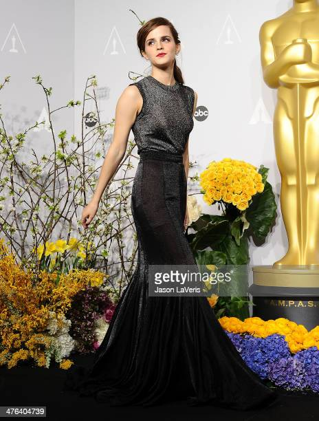 Actress Emma Watson poses in the press room at the 86th annual Academy Awards at Dolby Theatre on March 2 2014 in Hollywood California