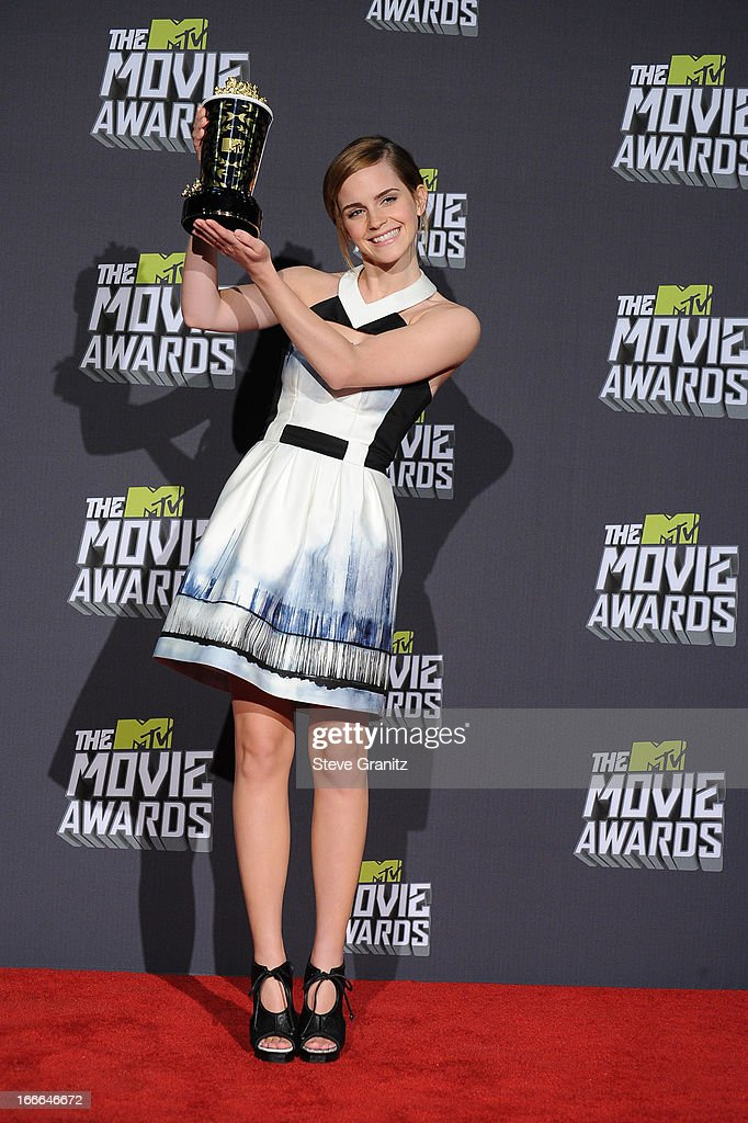 Actress <a gi-track='captionPersonalityLinkClicked' href=/galleries/search?phrase=Emma+Watson&family=editorial&specificpeople=171373 ng-click='$event.stopPropagation()'>Emma Watson</a> poses in the press room during the 2013 MTV Movie Awards at Sony Pictures Studios on April 14, 2013 in Culver City, California.