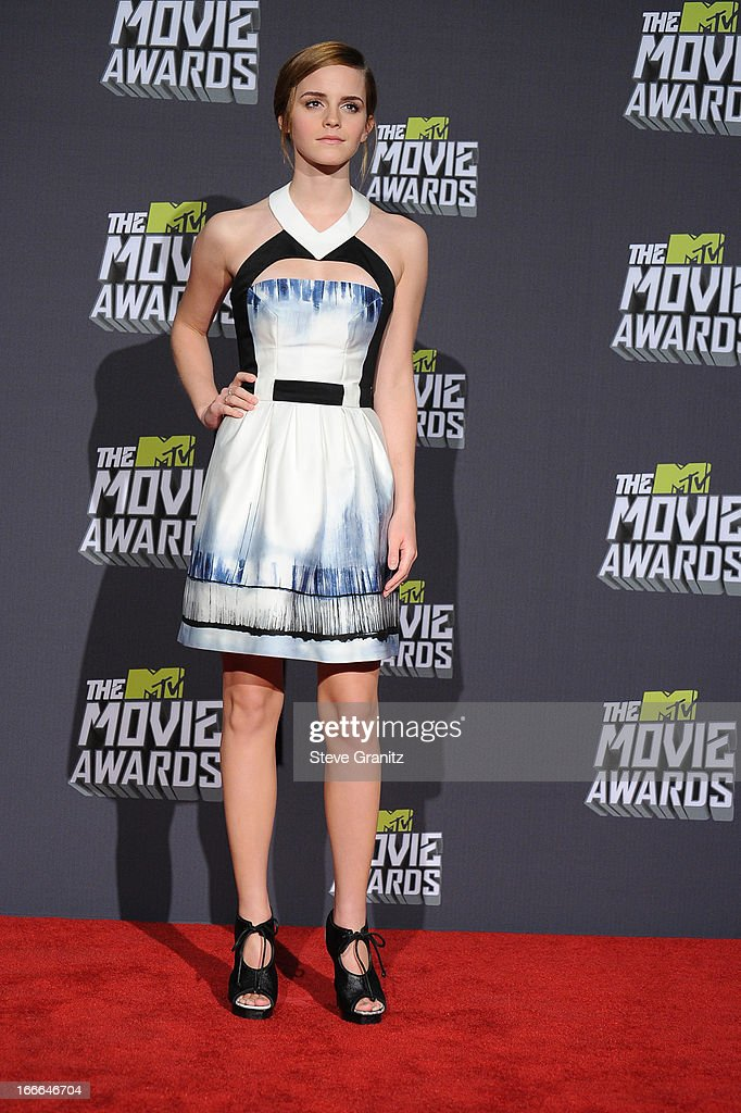 Actress Emma Watson poses in the press room during the 2013 MTV Movie Awards at Sony Pictures Studios on April 14, 2013 in Culver City, California.