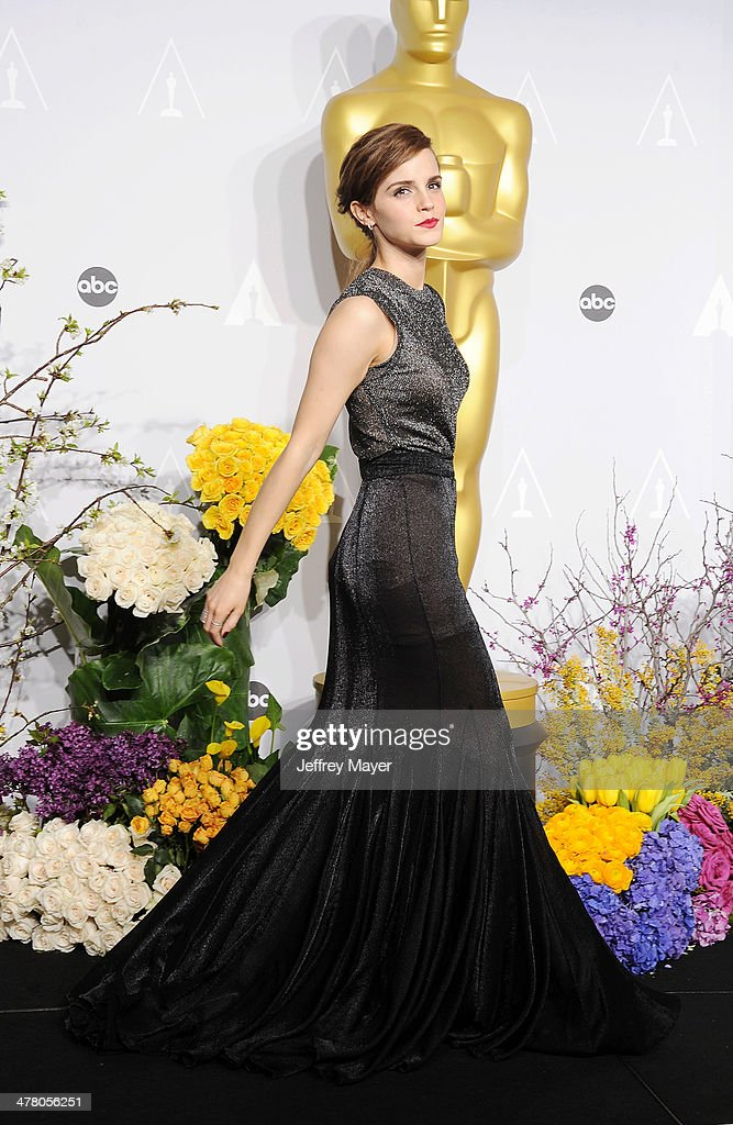 Actress <a gi-track='captionPersonalityLinkClicked' href=/galleries/search?phrase=Emma+Watson&family=editorial&specificpeople=171373 ng-click='$event.stopPropagation()'>Emma Watson</a> poses in the press room during the 86th Annual Academy Awards at Loews Hollywood Hotel on March 2, 2014 in Hollywood, California.
