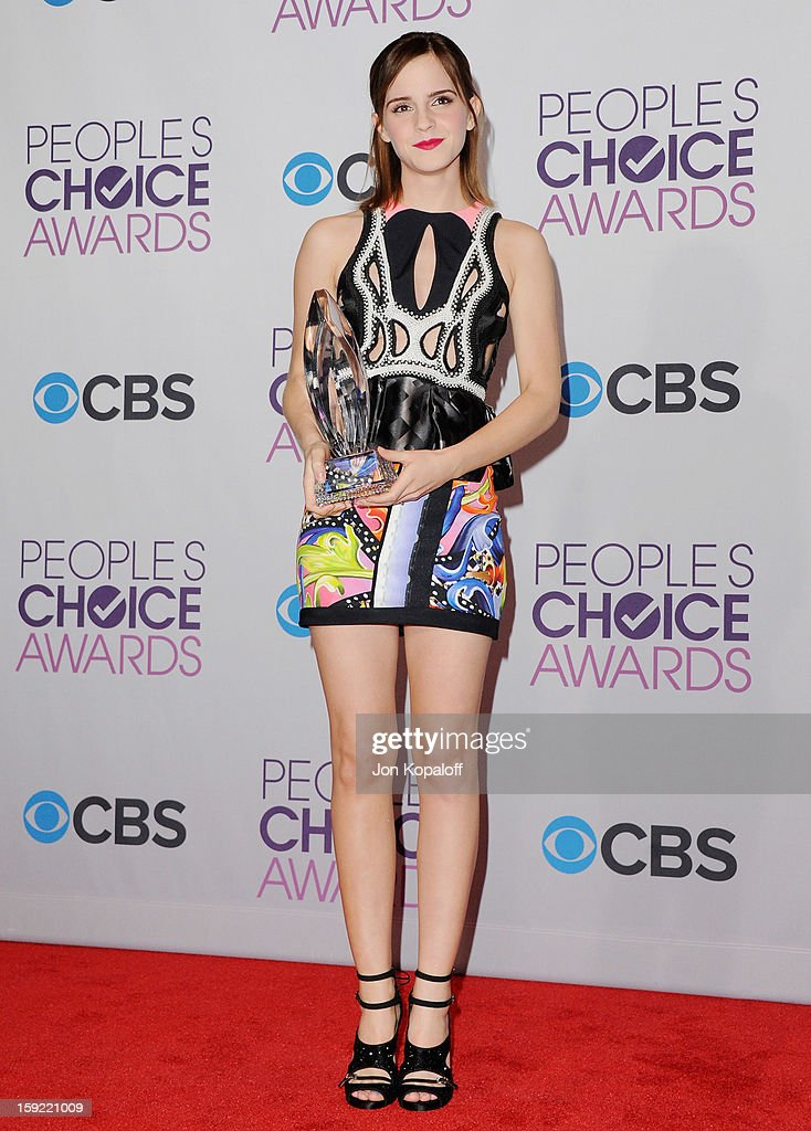 Actress Emma Watson poses in the pressroom at the 2013 People's Choice Awards at Nokia Theatre L.A. Live on January 9, 2013 in Los Angeles, California.