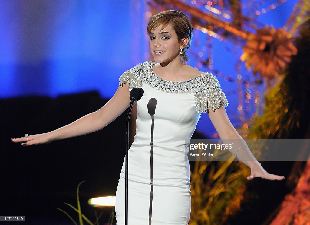 Actress <a gi-track='captionPersonalityLinkClicked' href=/galleries/search?phrase=Emma+Watson&family=editorial&specificpeople=171373 ng-click='$event.stopPropagation()'>Emma Watson</a> speaks onstage during the 2011 MTV Movie Awards at Universal Studios' Gibson Amphitheatre on June 5, 2011 in Universal City, California.