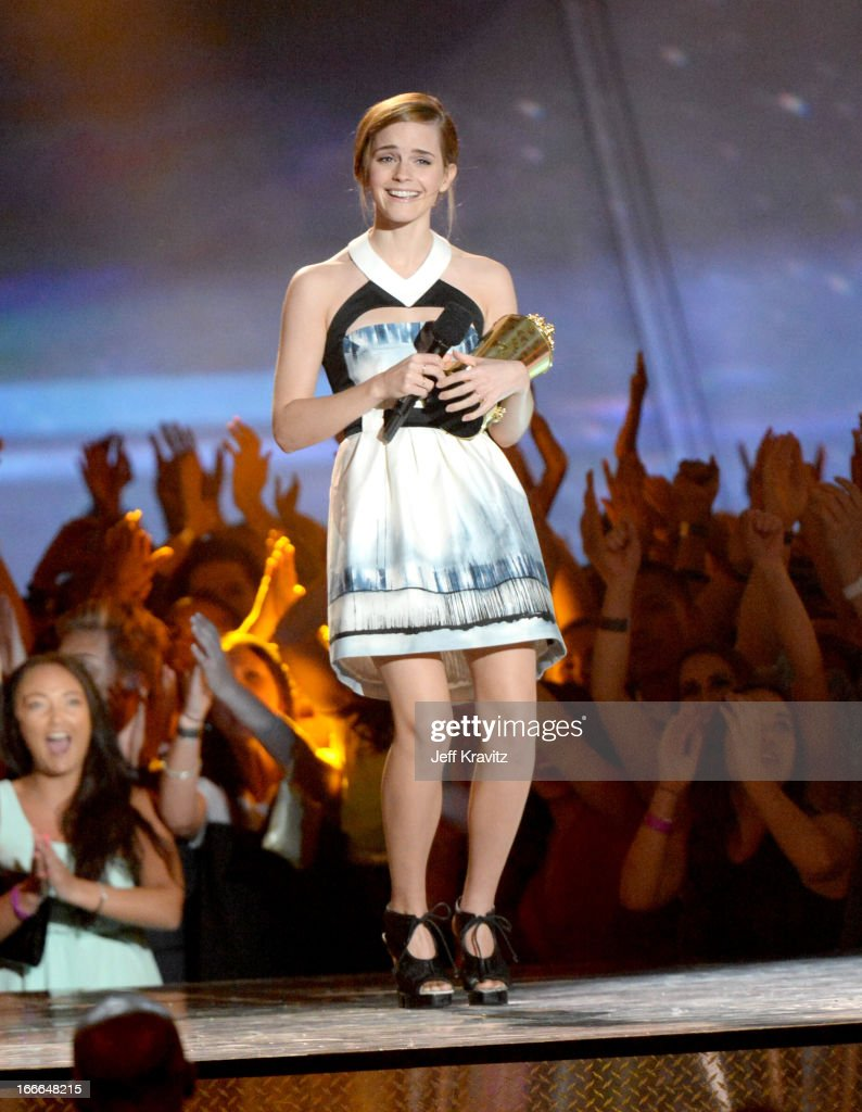 Actress Emma Watson speaks onstage during the 2013 MTV Movie Awards at Sony Pictures Studios on April 14, 2013 in Culver City, California.