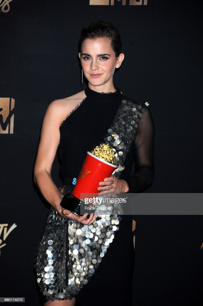 Actress Emma Watson, winner of Best Actor in a Movie award for 'Beauty and the Beast', poses in the press room during the 2017 MTV Movie And TV Awards at The Shrine Auditorium