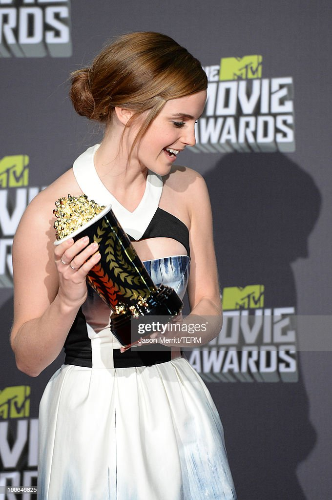 Actress Emma Watson, winner of the MTV Trailblazer Award, poses in the press room during the 2013 MTV Movie Awards at Sony Pictures Studios on April 14, 2013 in Culver City, California.