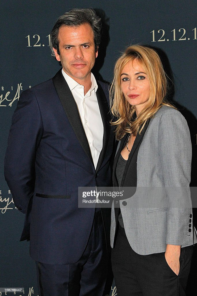 Actress <a gi-track='captionPersonalityLinkClicked' href=/galleries/search?phrase=Emmanuelle+Beart&family=editorial&specificpeople=171374 ng-click='$event.stopPropagation()'>Emmanuelle Beart</a> (R) and Guillaume Houze, Director of Sponsorship at Galeries Lafayette, attend the Galeries Lafayette 100th Anniversary Bal on December 12, 2012 in Paris, France.