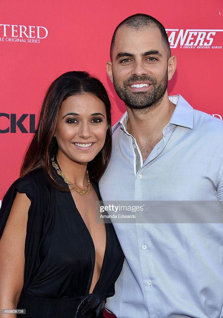 Actress <a gi-track='captionPersonalityLinkClicked' href=/galleries/search?phrase=Emmanuelle+Chriqui&family=editorial&specificpeople=541098 ng-click='$event.stopPropagation()'>Emmanuelle Chriqui</a> (L) and actor Adrian Bellani arrive at the Crackle Original Series' 'Cleaners' and 'Sequestered' summer premiere celebration at 1 OAK on August 14, 2014 in West Hollywood, California.