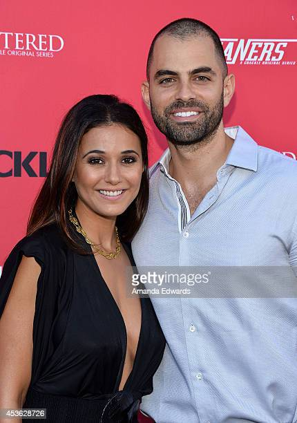 Actress Emmanuelle Chriqui and actor Adrian Bellani arrive at the Crackle Original Series' 'Cleaners' and 'Sequestered' summer premiere celebration...