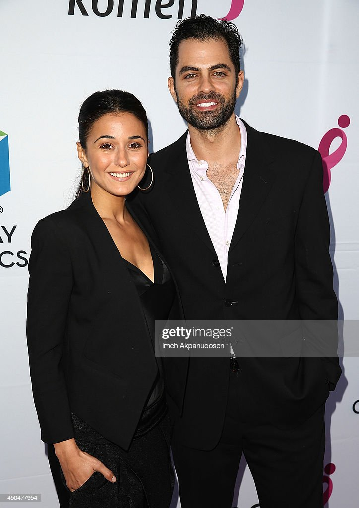 Actress <a gi-track='captionPersonalityLinkClicked' href=/galleries/search?phrase=Emmanuelle+Chriqui&family=editorial&specificpeople=541098 ng-click='$event.stopPropagation()'>Emmanuelle Chriqui</a> (L) and actor Adrian Bellani attend the Pathway To The Cures For Breast Cancer fundraiser benefiting Susan G. Komen presented by Relativity Media and Pathway Genomics at Santa Monica Airport on June 11, 2014 in Santa Monica, California.