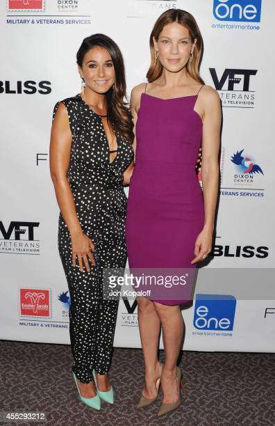 Actress Emmanuelle Chriqui and actress Michelle Monaghan arrive at the Los Angeles screening 'Fort Bliss' at DGA Theater on September 11 2014 in Los...
