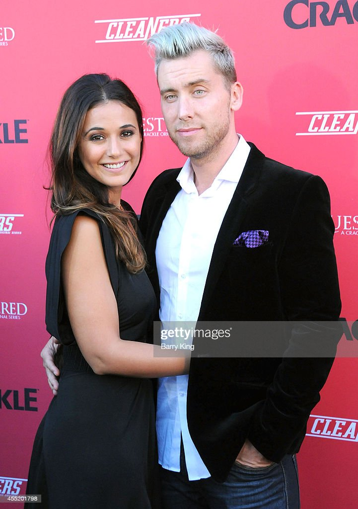 Actress <a gi-track='captionPersonalityLinkClicked' href=/galleries/search?phrase=Emmanuelle+Chriqui&family=editorial&specificpeople=541098 ng-click='$event.stopPropagation()'>Emmanuelle Chriqui</a> and singer <a gi-track='captionPersonalityLinkClicked' href=/galleries/search?phrase=Lance+Bass&family=editorial&specificpeople=210566 ng-click='$event.stopPropagation()'>Lance Bass</a> arrive at the Crackle Original Series' 'Cleaners' and 'Sequestered' Summer premiere celebration at 1 OAK on August 14, 2014 in West Hollywood, California.
