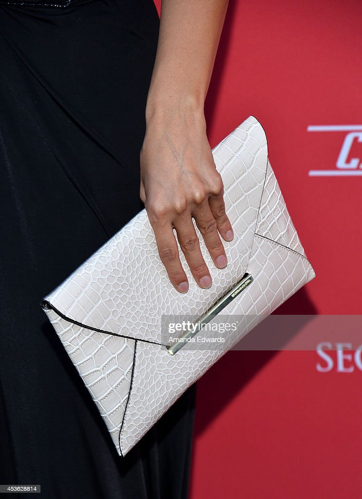 Actress <a gi-track='captionPersonalityLinkClicked' href=/galleries/search?phrase=Emmanuelle+Chriqui&family=editorial&specificpeople=541098 ng-click='$event.stopPropagation()'>Emmanuelle Chriqui</a> (clutch detail) arrives at the Crackle Original Series' 'Cleaners' and 'Sequestered' summer premiere celebration at 1 OAK on August 14, 2014 in West Hollywood, California.